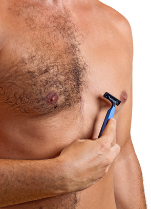 shaving of chest hair with a razor