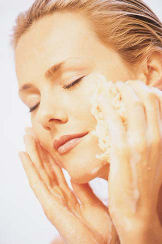 woman applying an anti-aging face cream