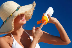 woman applying spf moisturizer for sun skin protection