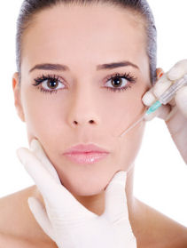 woman getting a cosmetic botox injection to eliminate wrinkles
