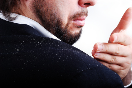 man with dandruff flakes on his shoulder looking for a dandruff cure