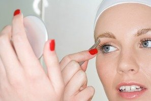 woman plucking hair from eyebrow as temporary hair removal