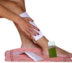 waxing hair removal treatment on leg